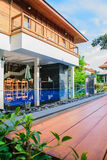 Wood Paquet with Swimming Pool and Tile Wall Stock Image