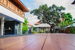Wood Paquet with Swimming Pool and Tile Wall Stock Photo