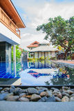 Wood Paquet with Swimming Pool and Tile Wall Royalty Free Stock Photography