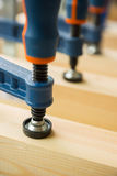 Wood pasting by clamps in a joiner's workshop Stock Photos