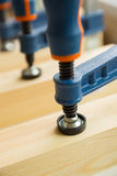 Wood pasting by clamps in a joiner's workshop Royalty Free Stock Image