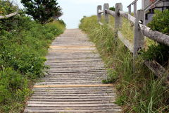 Wood path. Wooden path leading to the beach beyond lined by rural fencing Stock Images