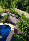 Wood patio & pool layout with landscaping Stock Photos