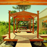 Wood pavilion, deck and tropical plants in summer resort Royalty Free Stock Images