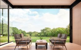 Wood pavillion with garden view 3d rendering image. There are woodden floors,wall and ceiling .Furnished with brown leather and wood furniture. Surounded with Royalty Free Stock Photos