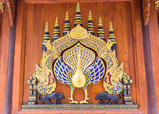 Wood peacock chair in thai temple,art lanna style Royalty Free Stock Image