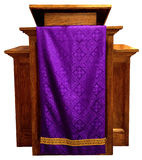 Church Pulpit, Christian Religion, Isolated. Wood pedestal or church pulpit, a common sight in a church for the Christian religion. A purple robe adds color and Stock Photography