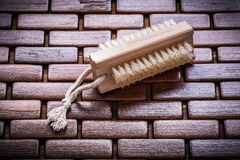 Wood peeling brush on textured wooden matting close up view heal Stock Photo