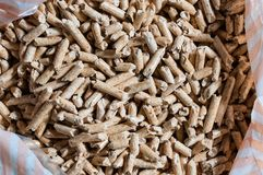 Wood pellet for heating. A bag of wood pellet. Horizontal composition Royalty Free Stock Photo