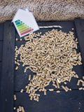 Wood pellet store and energy lable Royalty Free Stock Photos