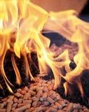 Wood pellets. Alternative fuel: Wood pellets burning in a fireplace Stock Image