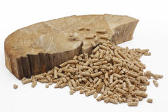 Wood pellets. And a piece of wood on a white background Stock Photos