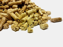 Wood Pellets Against White Backdrop Royalty Free Stock Photos