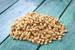 Wood pellets in the background. Biofuels. Wooden granules. stock photos