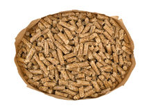 Wood pellets in a brown paper bag Royalty Free Stock Image
