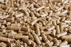 Wood pellets close up .Biofuels. Biomass Pellets - cheap energy. The cat litter royalty free stock images