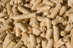 Wood pellets closeup. Red deal wood pellets green energy close-up Royalty Free Stock Image