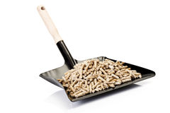 Wood pellets on Dustpan Royalty Free Stock Photography