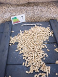 Wood pellets and energy label with question mark Stock Images