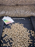 Wood pellets and energy lable Royalty Free Stock Photos