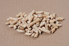 Wood pellets for heating. On brown background Royalty Free Stock Images