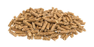Wood pellets pile on a white background Stock Photos