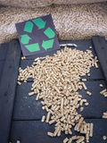 Wood pellets and recycling symbol Stock Photo