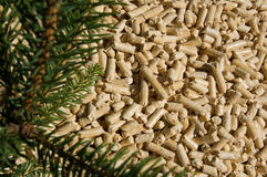 Wood pellets and red deal Stock Photo