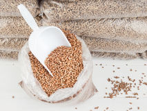 Wood pellets and scoop Royalty Free Stock Photo