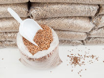 Wood pellets and scoop Stock Photos