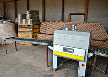 Wood pellets shop. Wood pellets machine in a manufacture shop Royalty Free Stock Photo