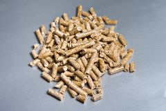 Wood pellets on a silver background. Biofuels. The Cat Litter stock images