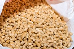 Wood pellets spill out of the packaging . Biofuels. The cat litter. royalty free stock photos