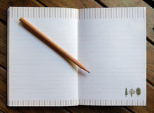 Wood Pencil on Notebook Royalty Free Stock Image