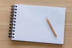 Wood Pencil Placed on a Notebook Royalty Free Stock Photo