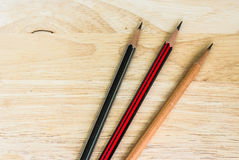 Wood Pencil on Wood Table Desk Royalty Free Stock Image