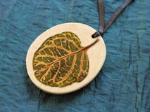 Wood pendant with natural leaf Stock Photos