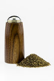 Wood pepper Shaker with pepper pile on a white background. Royalty Free Stock Images