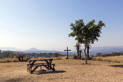 Wood Picnic Table and Seats on Hilltop in Dry Landscape Stock Photo