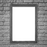 Wood picture frame on white brick wall Royalty Free Stock Photos