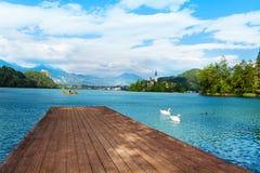 Wood pier on Bled lake Stock Image