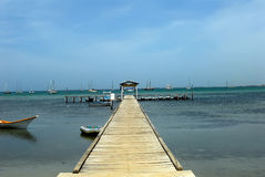 Wood pier and Caribbean ocean  Royalty Free Stock Photos