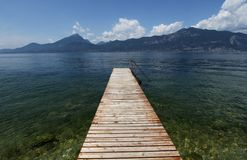 Wood pier on the Garda Lake. In North Italy stock photo