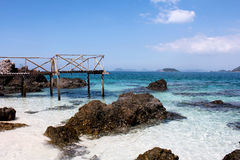 Wood pier, rock, blue sea and blue sky. In Thailand Stock Photos