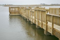 Wood pier in the water Royalty Free Stock Photos