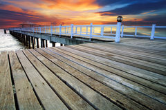 Wood piers and pavillion sea scene with dusky sky use for natura Royalty Free Stock Images