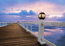 Wood piers and sea scene with dusky sky use for natural background ,backdrop Royalty Free Stock Images