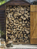 Wood pile. Wood stacked for winter in a shed Royalty Free Stock Images