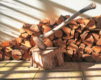 A Wood Pile With Axe Royalty Free Stock Photo