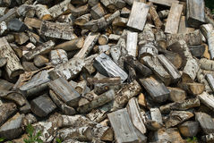 Wood Pile Background. A background of chopped wood lying in a large pile Stock Photos